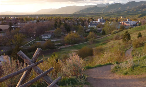 Sunset view of the city of Bozeman, Montana, where Headwaters Economics is based.