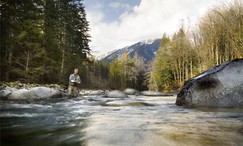 A fisherman on the North Fork Skykomish River in the North Cascades.